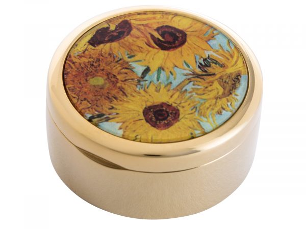 """This beautifully crafted Pill Box by Parastone comes with a stunning extract from Vincent Van Gogh's """"Sunflowers"""" painted in 1888. Vincent Van Gogh's Sunflowers is made of two separate paintings, one painted in 1987 was of sunflowers laid on the ground, the second a year later in 1988 with sunflowers in a vase. Size: Diameter: 5 cm - 2"""" By John Beswick / Parastone Product Code: P01GOG(G)"""
