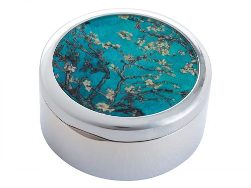 "This beautifully crafted Pill Box created by Parastone features an extract from Vincent Van Goghs ""Almond Blossoms"". Almond Blossoms is from a group of several paintings made in 1888 and 1890 by Vincent van Gogh in Arles and Saint-Rémy, southern France of blossoming almond trees. Flowering trees were special to van Gogh. They represented awakening and hope. He enjoyed them aesthetically and found joy in painting flowering trees. Size: Diameter: 5 cm - 2"" By John Beswick / Parastone Product Code: P02GOG(S)"