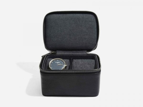 This beautifully made Stackers Black Large Travel Watch Box is made from vegan leather and cotton, a stylish and elegant way to customise the way you store your items. Allowing you to travel in style. Size: 11.5cm x 14.5cm x 8cm By Stackers Product Code: 75397
