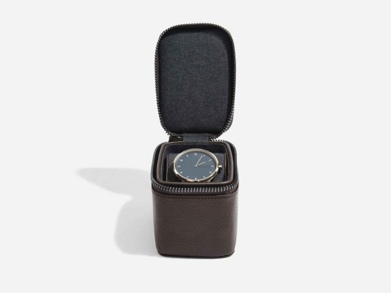 This beautifully made Stackers Brown Small Travel Watch Box is made from vegan leather and cotton, a stylish and elegant way to customise the way you store your items. Allowing you to travel in style. Size: 10.5cm x 7.5cm x 8cm By Stackers Product Code: 75394