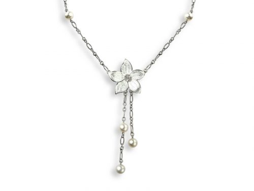 A Nicole Barr necklace inspired by the Stephanotis flower decorated with white sapphires.