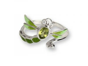 The dragonfly wraps around your finger with it's green enamel, Peridot and white sapphires. Made by Nicole Barr
